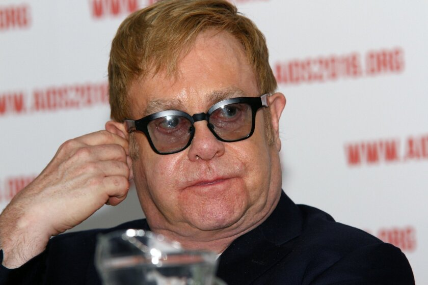 British musician Elton John hosts a press conference at the 21st World Aids Conference 2016 in Durban, South Africa, Wednesday, July 20, 2016. John says that leaving LGBT people behind in the fight against AIDS will only increase the spread of the disease. (AP Photo)