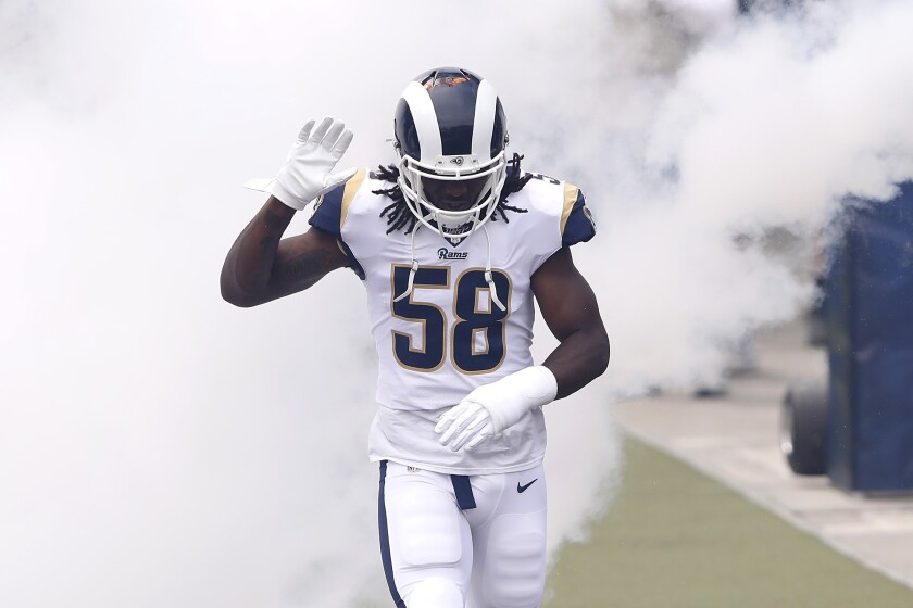 Cory Littleton of the Los Angeles Rams runs onto the field before the game against the New Orleans Saints at Los Angeles Memorial Coliseum on September 15.