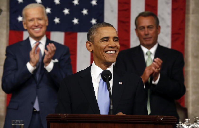 President Obama delivers the State of Union address before a joint session of Congress in the House chamber in Washington as Vice President Joe Biden and House Speaker John Boehner of Ohio applaud.