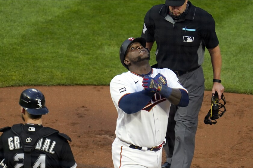 Minnesota Twins' Miguel Sano celebrates his solo home run in the fourth inning of a baseball game Tuesday, May 18, 2021, in Minneapolis. (AP Photo/Jim Mone)