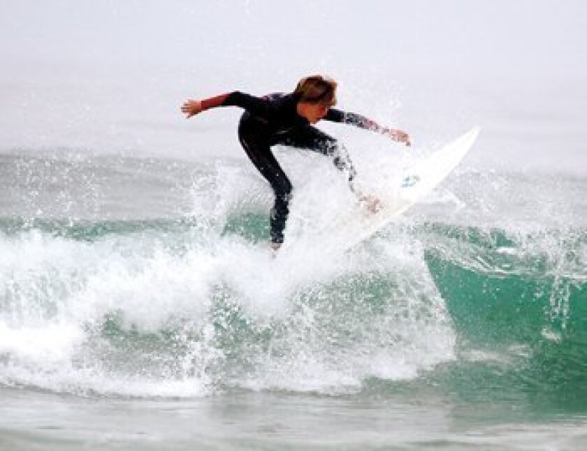A competitor in the Menehune Junior Surf Contest practices at the Shore. Photos by Brittany Comunale