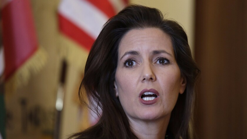 Mayor Libby Schaaf answers questions during a news conference at City Hall in Oakland, Calif.