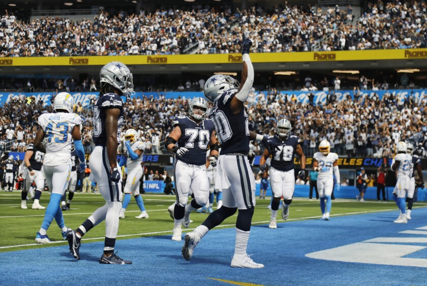 Dallas Cowboys running back Tony Pollard acknowledges the crowd after scoring a touchdown.