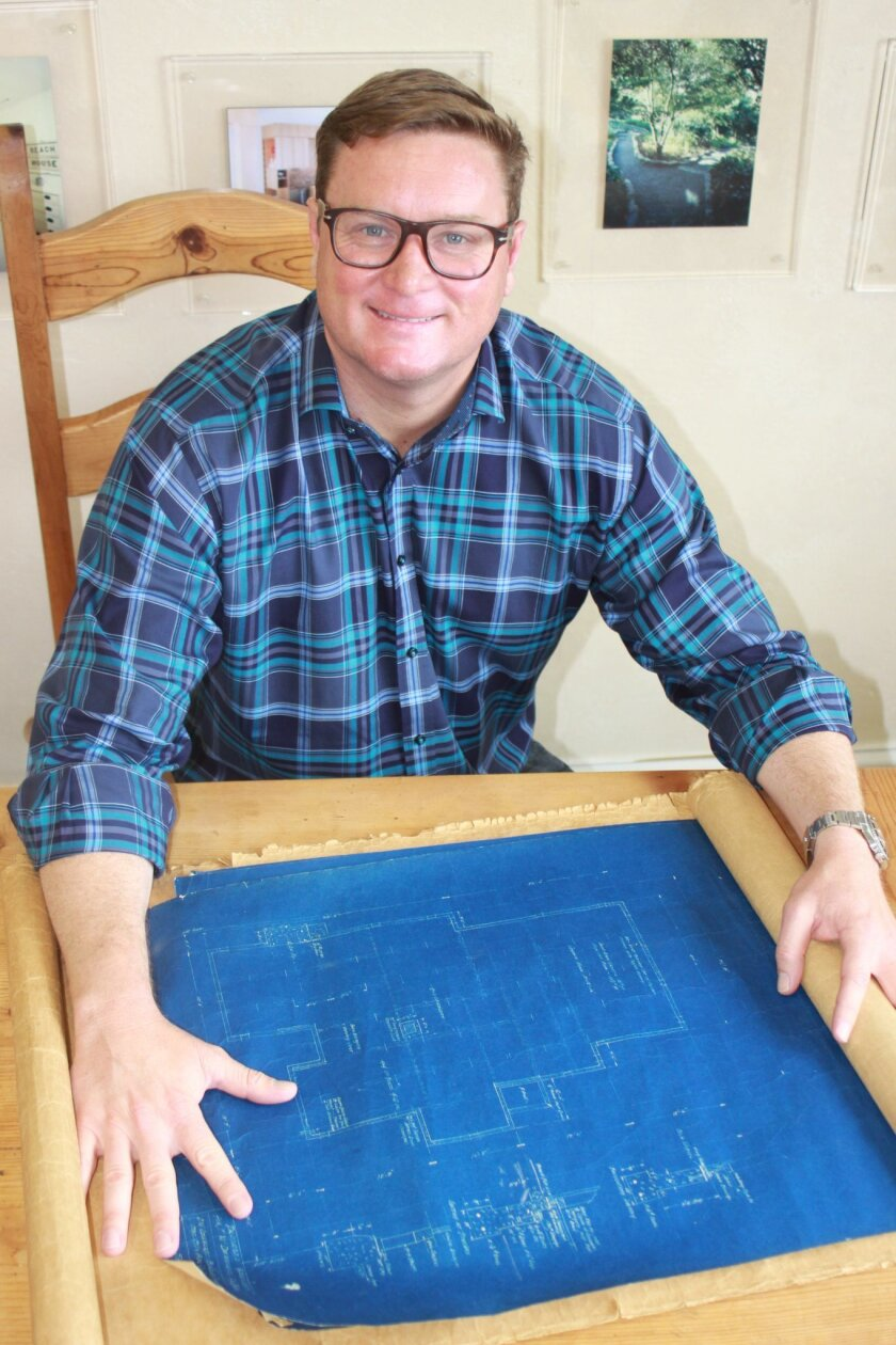 Fourth-generation La Jolla builder Pancho Dewhurst with the original blueprints for his great-grandfather's house.