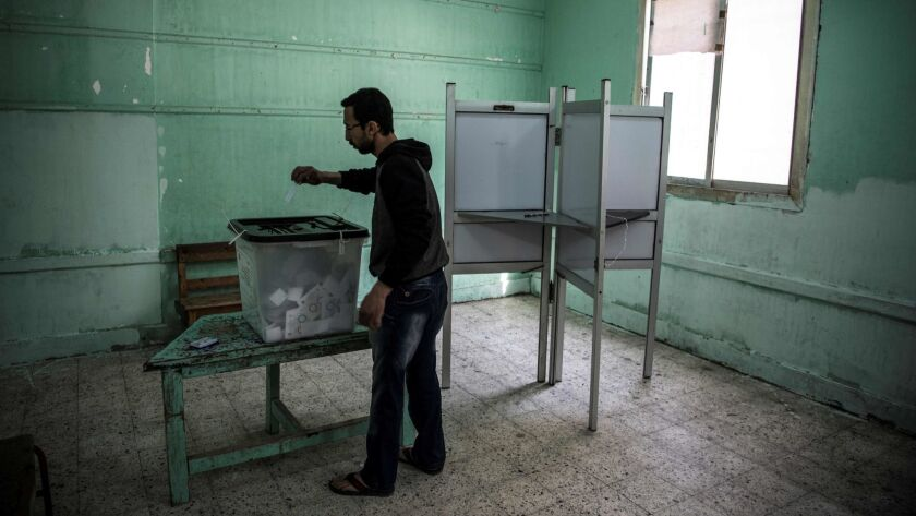 An Egyptian man casts his vote in Cairo on Monday, the third day of a constitutional referendum.