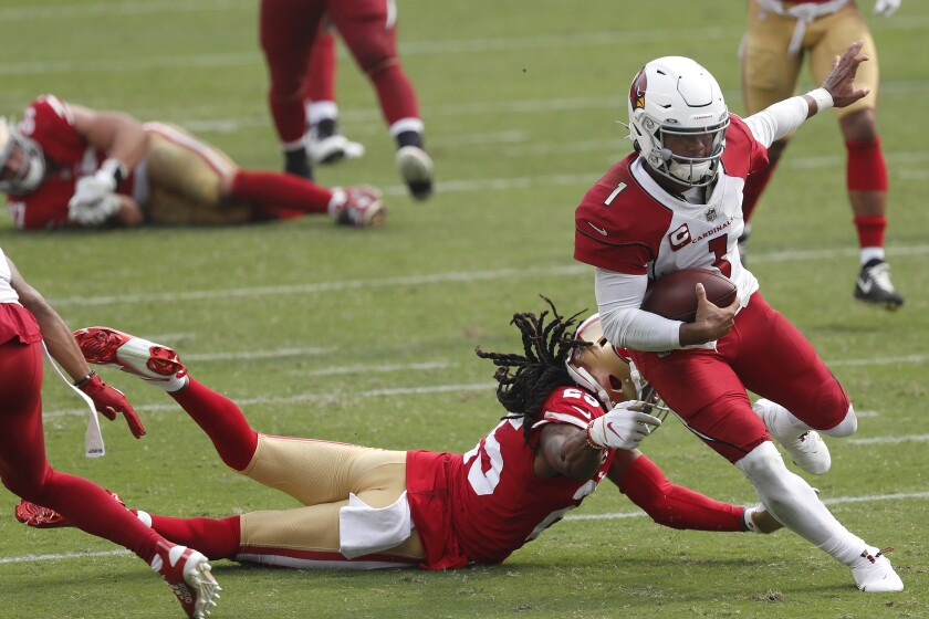 Arizona Cardinals quarterback Kyler Murray (1) runs past San Francisco 49ers cornerback Richard Sherman to score a touchdown during the second half of an NFL football game in Santa Clara, Calif., Sunday, Sept. 13, 2020. (AP Photo/Josie Lepe)