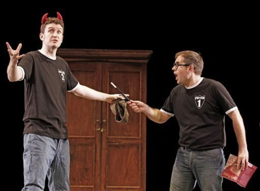 "This undated theater image released by David Gersten & Associates, Jefferson Turner, left, and Daniel Clarkson are shown during a performance of ""Potted Potter,"" in New York. Producers said Wednesday, April 10, 2013, the off-Broadway's Little Shubert Theatre will once again house the 70-minute paro"