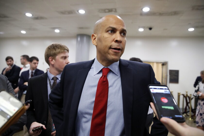 Sen. Cory Booker (D-N.J.) speaks to reporters on Capitol Hill.