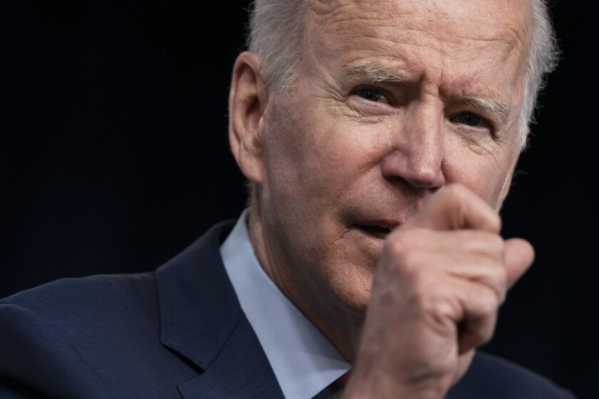 President Biden gestures in a close-up image.