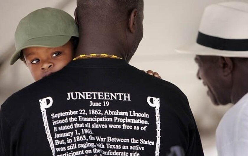 The T-shirt of this Juneteenth celebration attendee tells the story behind the historic June 19, 1865 date.