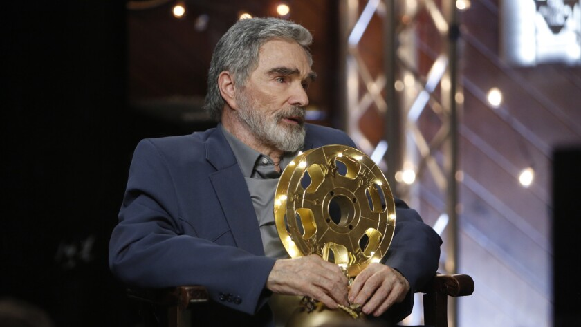 """Vic Edwards (Burt Reynolds) sits with a trophy in a scene from """"The Last Movie Star."""" Credit: A24 /"""