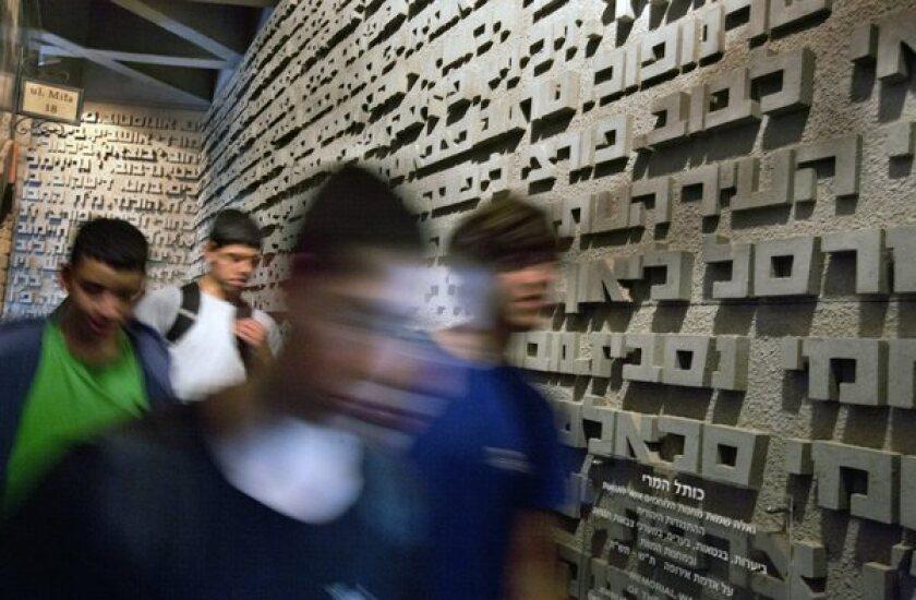 Israeli schoolchildren visit the Holocaust Museum in Kibbutz Yad Mordechai as part of Holocaust Remembrance Day.