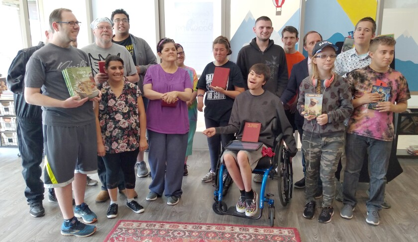 Ramona High School special needs students were the first customers to buy books at the Bookworm Bookstore opening at Generations Day Care.