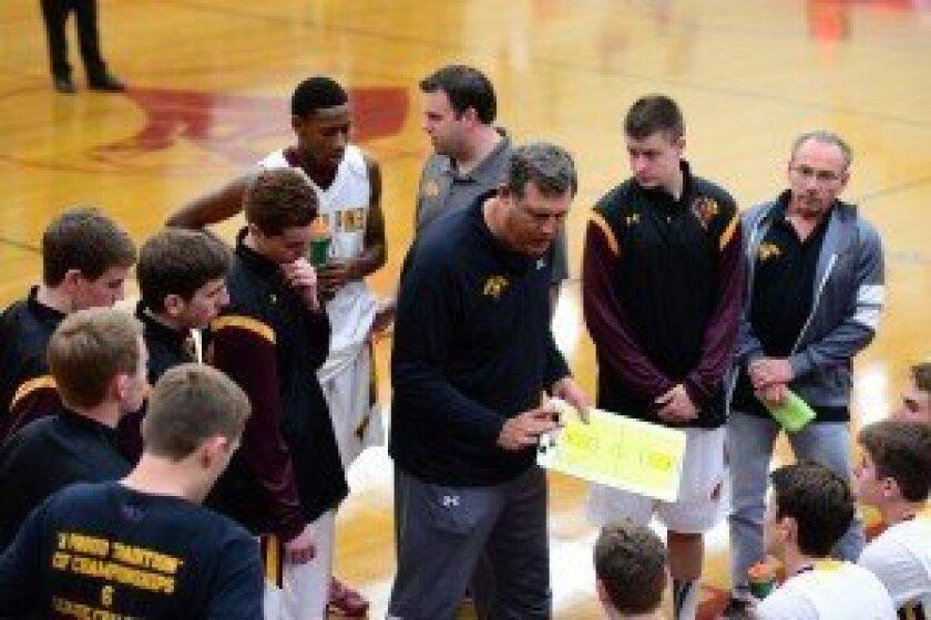 Coach John Olive (center). Photo/Anna Scipione