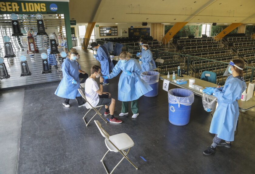 Nursing students administer Covid tests to students in the gymnasium at Point Loma Nazarene University on Thursday, Oct. 15
