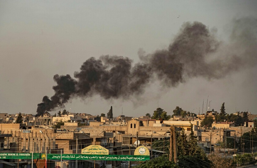 Smoke from Turkey's bombardment of Kurdish forces in Syria