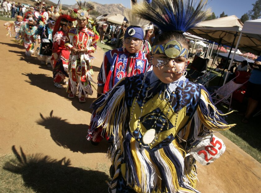 In this file photo, Robert Franco, 5, of Imperial Beach, and other youngsters wearing traditional clothing are introduced at the Grand Entrance of the Barona Powwow several years ago.