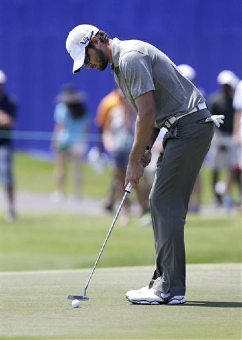 Kyle Stanley putts on the 18th green during the third round of the PGA Zurich Classic golf tournament at TPC Louisiana in Avondale, La., Saturday, April 27, 2013. (AP Photo/Gerald Herbert)