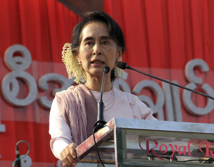 In this Saturday, Jan. 10, 2015 photo, Myanmar's opposition leader Aung San Suu Kyi speaks at the opening ceremony of fund raising concert of 4th anniversary of education network of her National League for Democracy party in Yangon, Myanmar. The Dalai Lama has urged Suu Kyi, a fellow Nobel Peace Prize laureate, to speak out to protect Myanmar's persecuted Rohingya Muslims. The Dalai Lama, the spiritual leader of Tibetan Buddhists, told The Australian newspaper that he has discussed the issue with Suu Kyi twice. Thousands of Rohingya have fled Myanmar, where they have faced violence from the Buddhist majority. (AP Photo/Khin Maung Win)