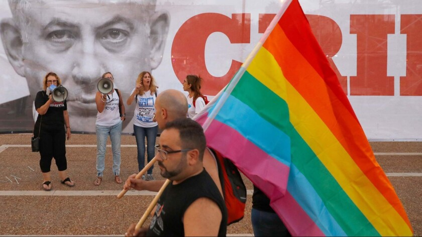 Participants attend a demonstration in Tel Aviv on July 22 to protest a new surrogacy law that does not include gay couples.