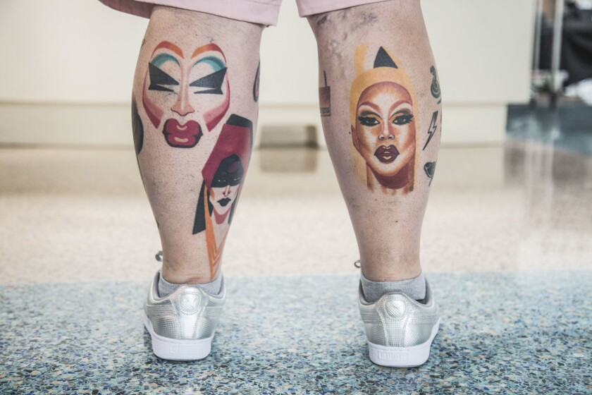 LOS ANGELES, CA. - May 11, 2018: James Robinson shows off his tattoos of Trixie Mattel (left), Deto
