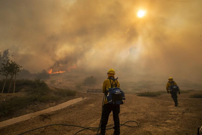 Orange County firefighters amid the smoke of the Silverado fire in Irvine.