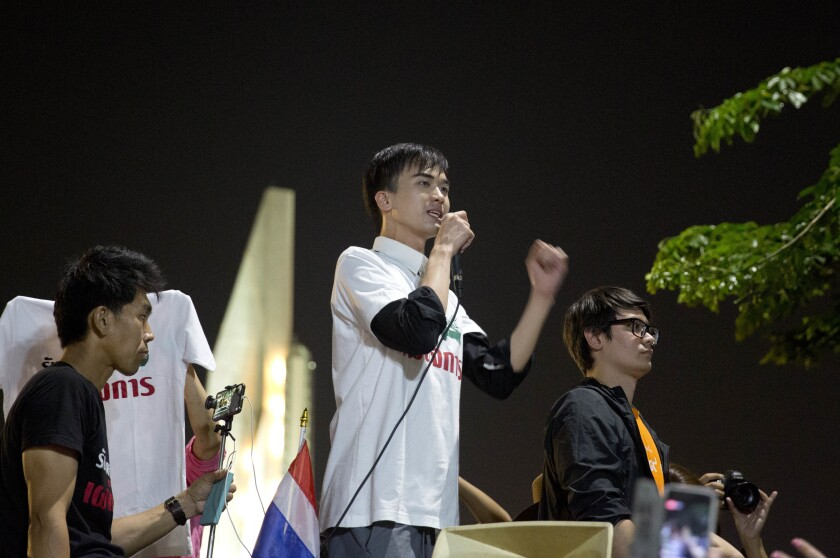 "FILE- in this Feb. 10, 2018, file photo, activist Karn Pongpraphapan addresses the audience during a protest near the democracy monument n Bangkok, Thailand. Police have arrested Karn for his content posted on the internet about how other countries' royal families lost their power and charged him with ""posting content that is a threat to national security."" (AP Photo, file)"