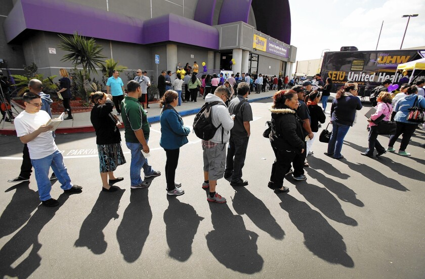 Californians brave long lines in the city of Commerce in 2014 to sign up for health coverage under the Affordable Care Act.