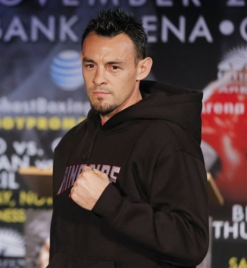 FILE - In this Oct. 23, 2012 file photo, boxer Robert Guerrero is photographed during a news conference in Los Angeles. Guerrero was arrested at New York's Kennedy Airport after police said he tried to bring a gun on a plane. Queens District Attorney Richard Brown said Guerrero was arrested Thursda