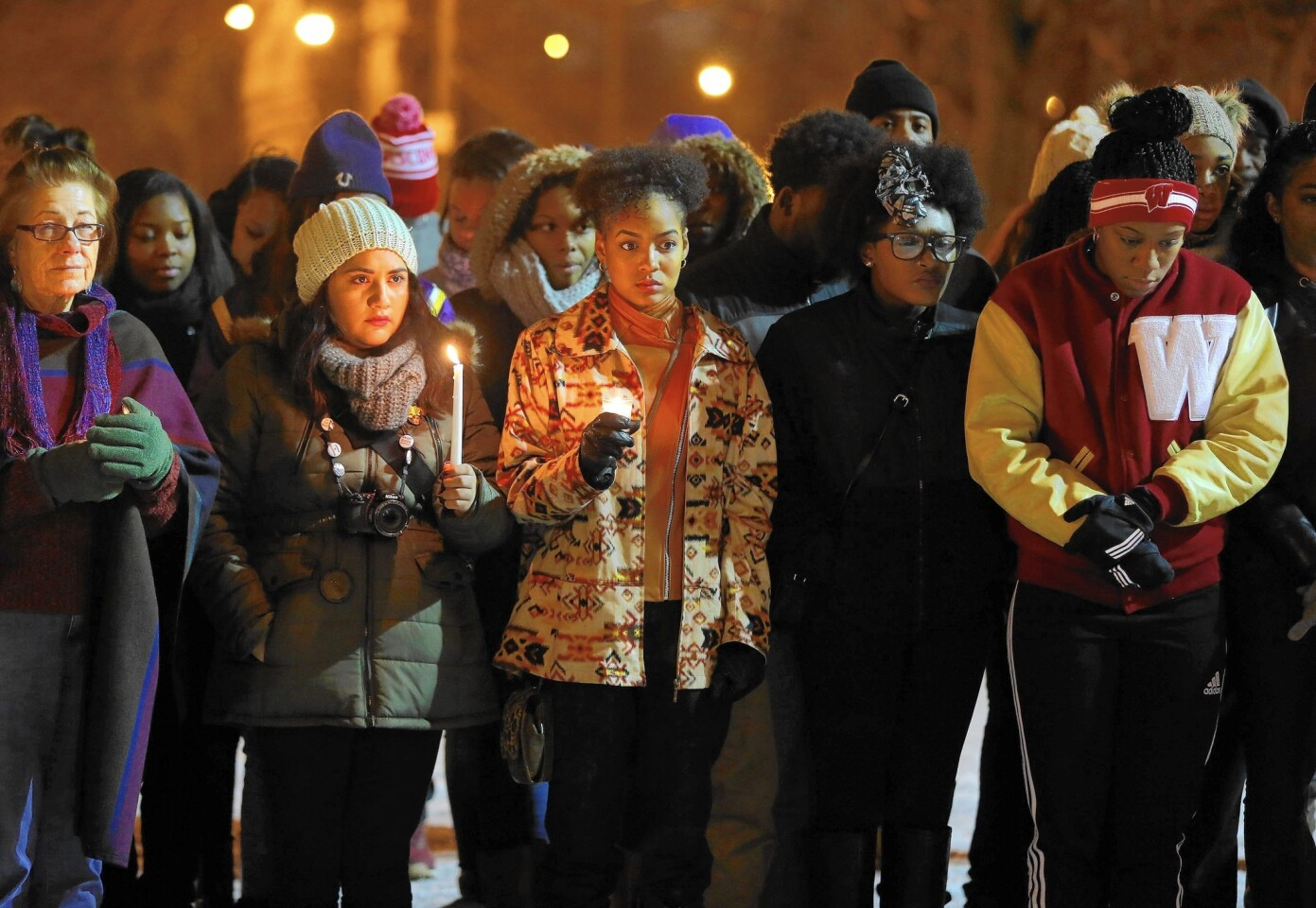 People gather to honor Quintonio LeGrier near Gwendolyn Brooks College Preparatory Academy in Chicago on Dec. 29, 2015. LeGrier, a graduate of the South Side school, was fatally shot by Chicago police responding to a domestic disturbance call Dec. 26 at the West Garfield Park apartment building where LeGrier lived. Police also fatally shot neighbor Bettie Jones, accidentally, who was a mother of five.