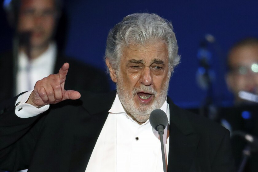 FILE - In this Aug. 28, 2019, file photo, opera singer Placido Domingo performs during a concert in Szeged, Hungary. A senior member of the main U.S. union that represents opera performers resigned Monday, March 2, 2020, accusing the leadership of a cover-up in its investigation into accusations of sexual harassment against superstar Plácido Domingo. Samuel Schultz, a baritone and elected officer of the American Guild of Musical Artists, had provided the full findings of the union's investigation to The Associated Press, which he said AGMA's leadership had planned to keep secret as part of an agreement with Domingo.(AP Photo/Laszlo Balogh, File)