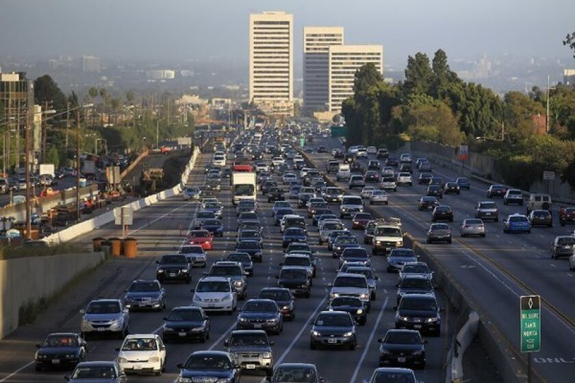 Traffic crawls along the northbound 405 Freeway during rush hour in the spring in Westwood.