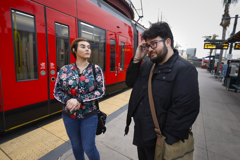 SAN DIEGO, CA 4/4/2019: Ana Montiel, left, and her brother Sergio Montiel, right, live in Tijuana, and ride the Trolley from the San Ysidro Trolley Station to San Diego City College where they are both students and Ana also works there. They gave their feelings on the potential for a border shutdown by President Trump. Photo by Howard Lipin/San Diego Union-Tribune/Mandatory Credit: HOWARD LIPIN SAN DIEGO UNION-TRIBUNE/ZUMA PRESS