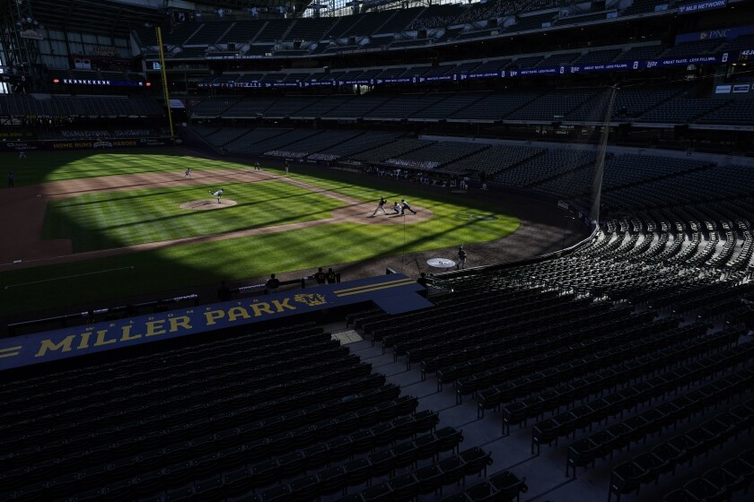 The seats at Miller Park are empty during the ninth inning of a baseball game between the Milwaukee Brewers and the Pittsburgh Pirates Sunday, Aug. 30, 2020, in Milwaukee. (AP Photo/Morry Gash)
