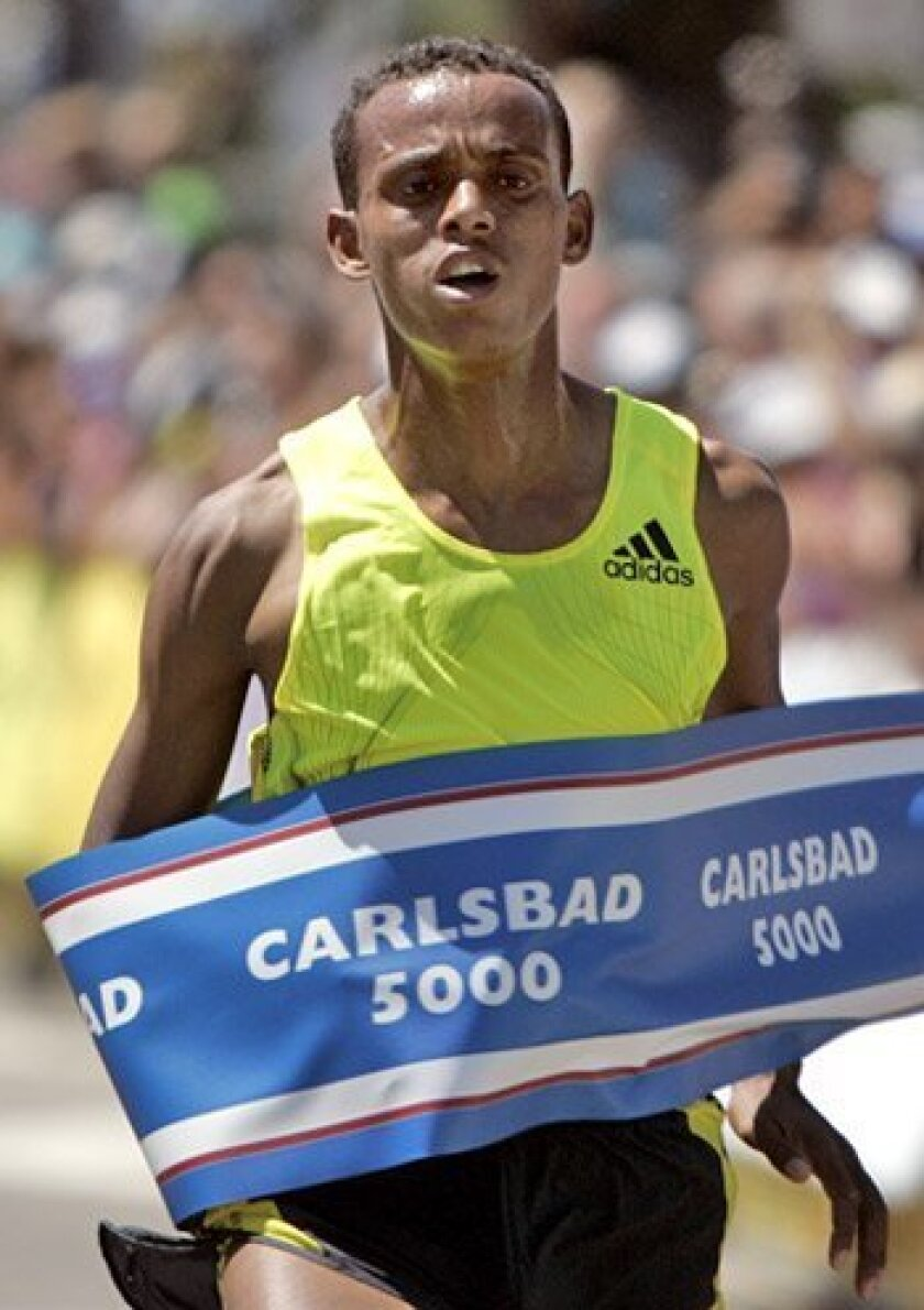 Bekana Daba of Ethiopia takes the Carlsbad 5000 with a time of 13 minutes, 19 seconds.  (Crissy Pascual / Union-Tribune)