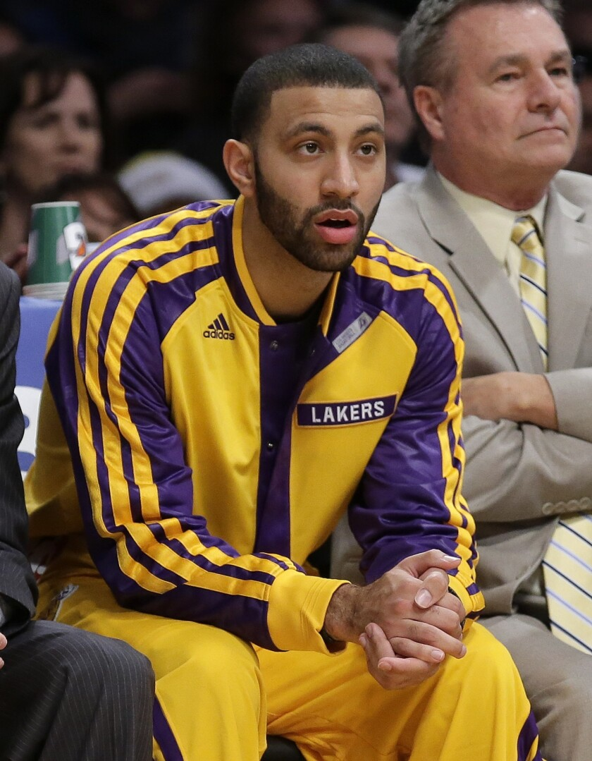Newly acquired Lakers point guard Kendall Marshall watches from the bench during Friday's 104-91 win over the Minnesota Timberwolves.
