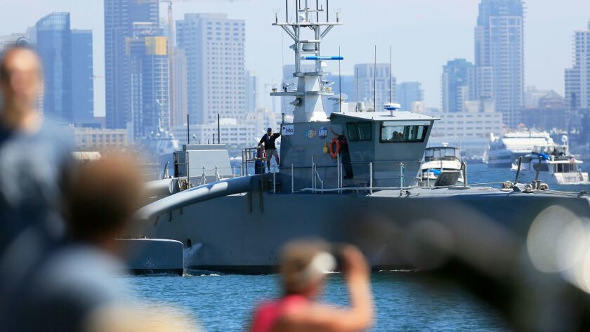 An Anti-Submarine Continuous Trail Unmanned Vessel (ACTUV) travels through San Diego Bay at high speeds.
