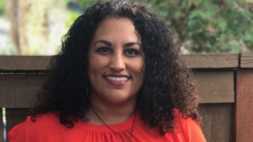Beatriz Palmer received the Salute to Women of Color Award from the NAACP — North San Diego County National Association for the Advancement of Colored People.