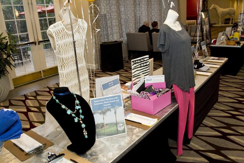 Silent auction items at the pre-golf tournament evening reception.