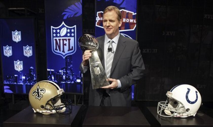 NFL Commissioner Roger Goodell holds the Vince Lombardi Trophy after a news conference Friday, Feb. 5, 2010 in Fort Lauderdale, Fla. The New Orleans Saints will play the Indianapolis Colts in Super Bowl XLIV Sunday, Feb. 7, at Sun Life Stadium in Miami. (AP Photo/David J. Phillip)