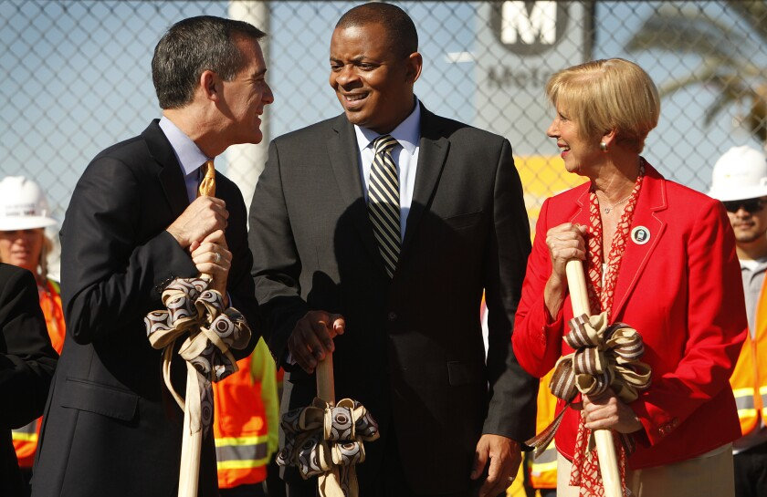 Los Angeles Mayor Eric Garcetti, U.S. Secretary of Transportation Anthony Fox and Rep. Janice Hahn (D-San Pedro), left to right, at the groundbreaking for the Downtown Regional Connector rail project in September. Foxx came to Los Angeles Thursday to urge Congress to approve more funding for highway and rail projects.