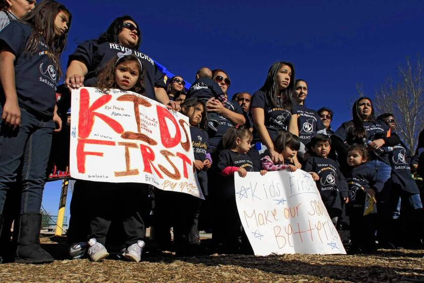 Parents of children at Desert Trails Elementary School in Adelanto rally at a local park in January before presenting a petition to the principal.