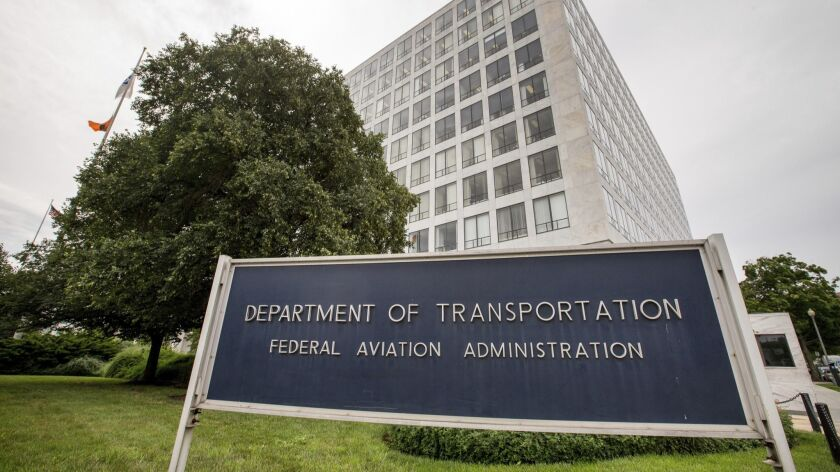 FILE - In this June 19, 2015 file photo, Department of Transportation Federal Aviation Administratio