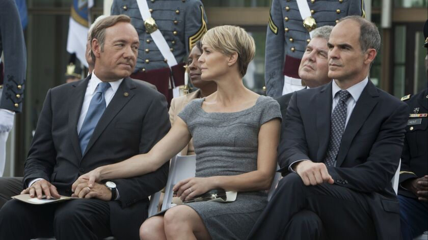 "Kevin Spacey, Robin Wright and Michael Kelly in a scene from Netflix's ""House of Cards."" Photo credi"