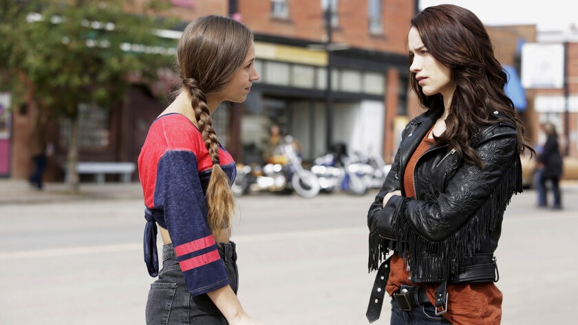 """A gunfighter's great-granddaughter (Melanie Scrofano, right) inherits his curse in """"Wynonna Earp"""" on Syfy. With Dominique Provost."""