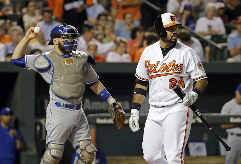 Baltimore Orioles designated hitter Pedro Alvarez, right, walks off the field past Toronto Blue Jays catcher Russell Martin after striking out during the fourth inning of a baseball game in Baltimore, Wednesday, Aug. 31, 2016. Toronto won 5-3. (AP Photo/Patrick Semansky)