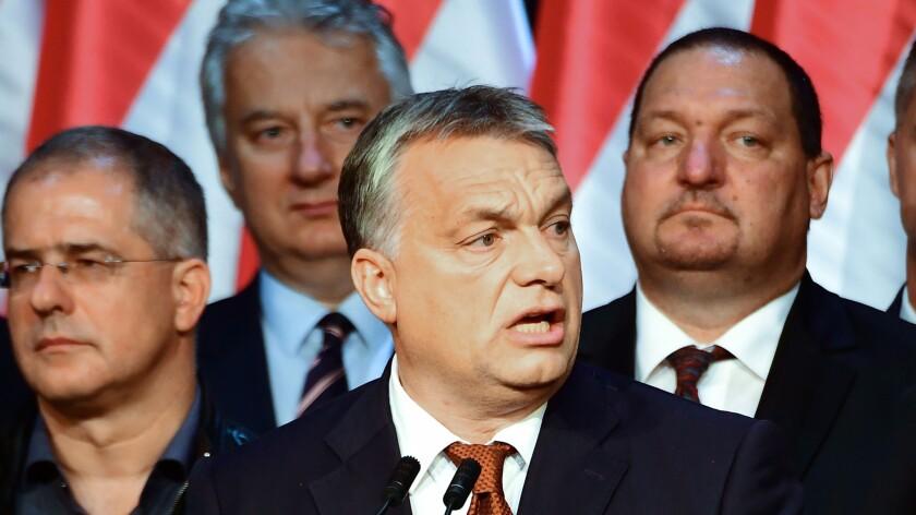 Hungarian Prime Minister Viktor Orban, center, gives a speech in Budapest on Oct. 2, 2016.