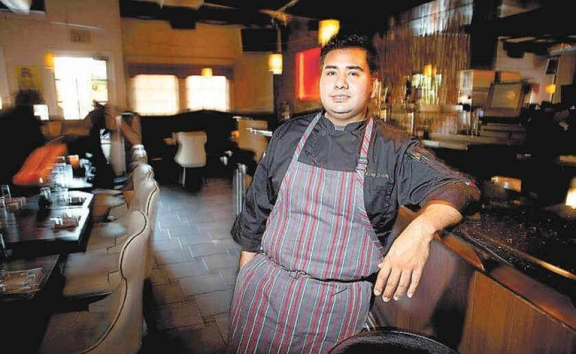 Anthony Sinsay, the former executive chef of Miso Harney Sushi's two locations.