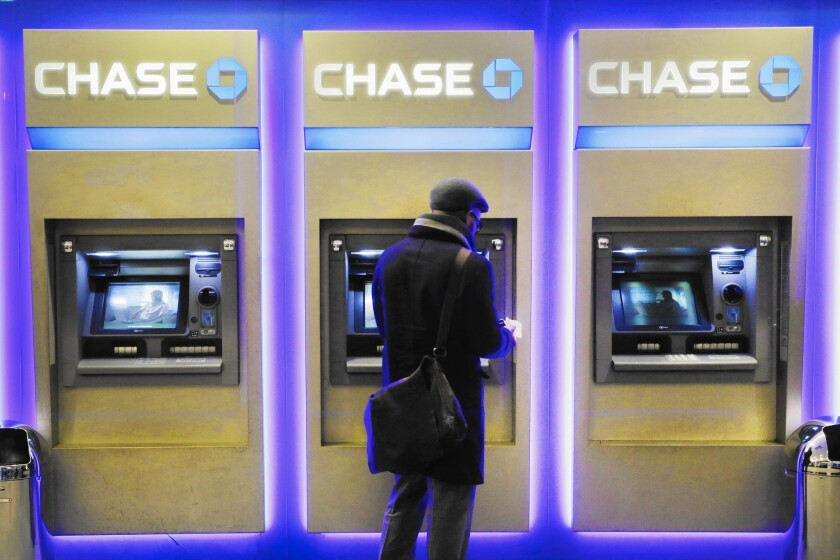The addition of cardless ATMs comes as banks are trying to push customers to do more transactions online, on their phones or through ATMs. Above, at a branch last year in New York.