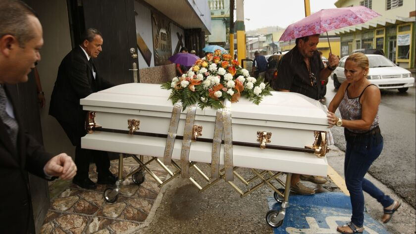 A funeral is held shortly after Hurricane Maria hit Puerto Rico in September 2017. The official estimated death toll is 64, but a new analysis finds the true figure could be 70 times higher.